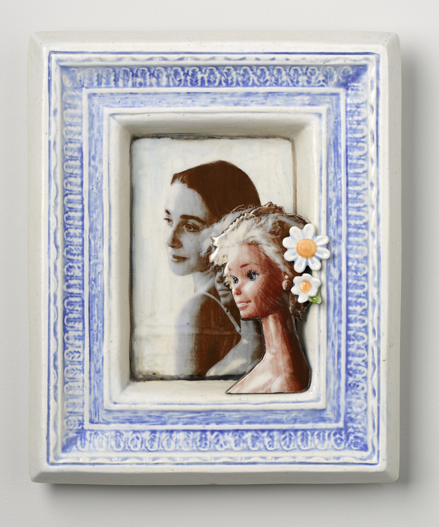 Portraits of girl and barbie in ceramic blue and white frame
