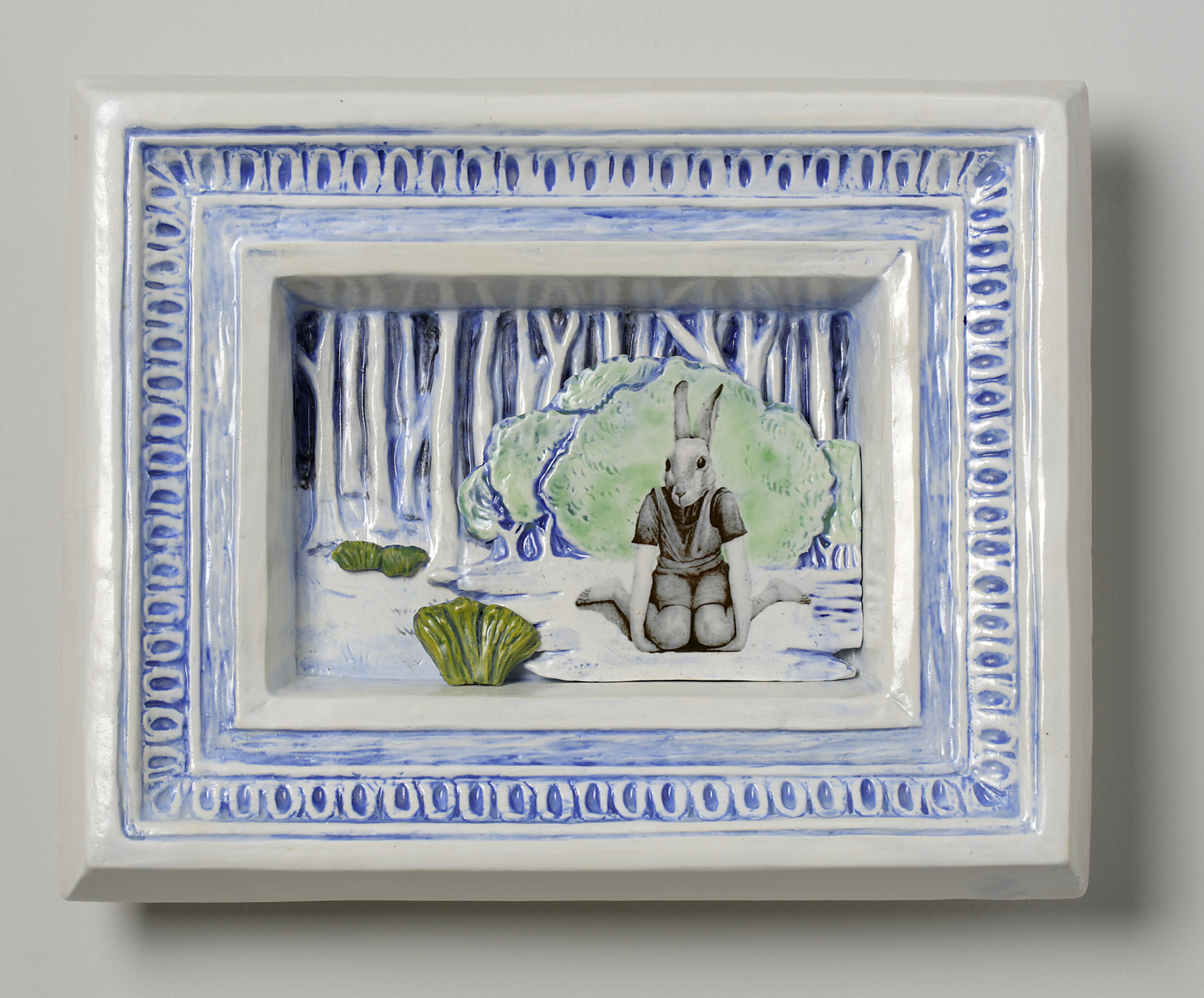 Rabbit headed girl sitting in front of trees and bushes, relief and decals in ceramics