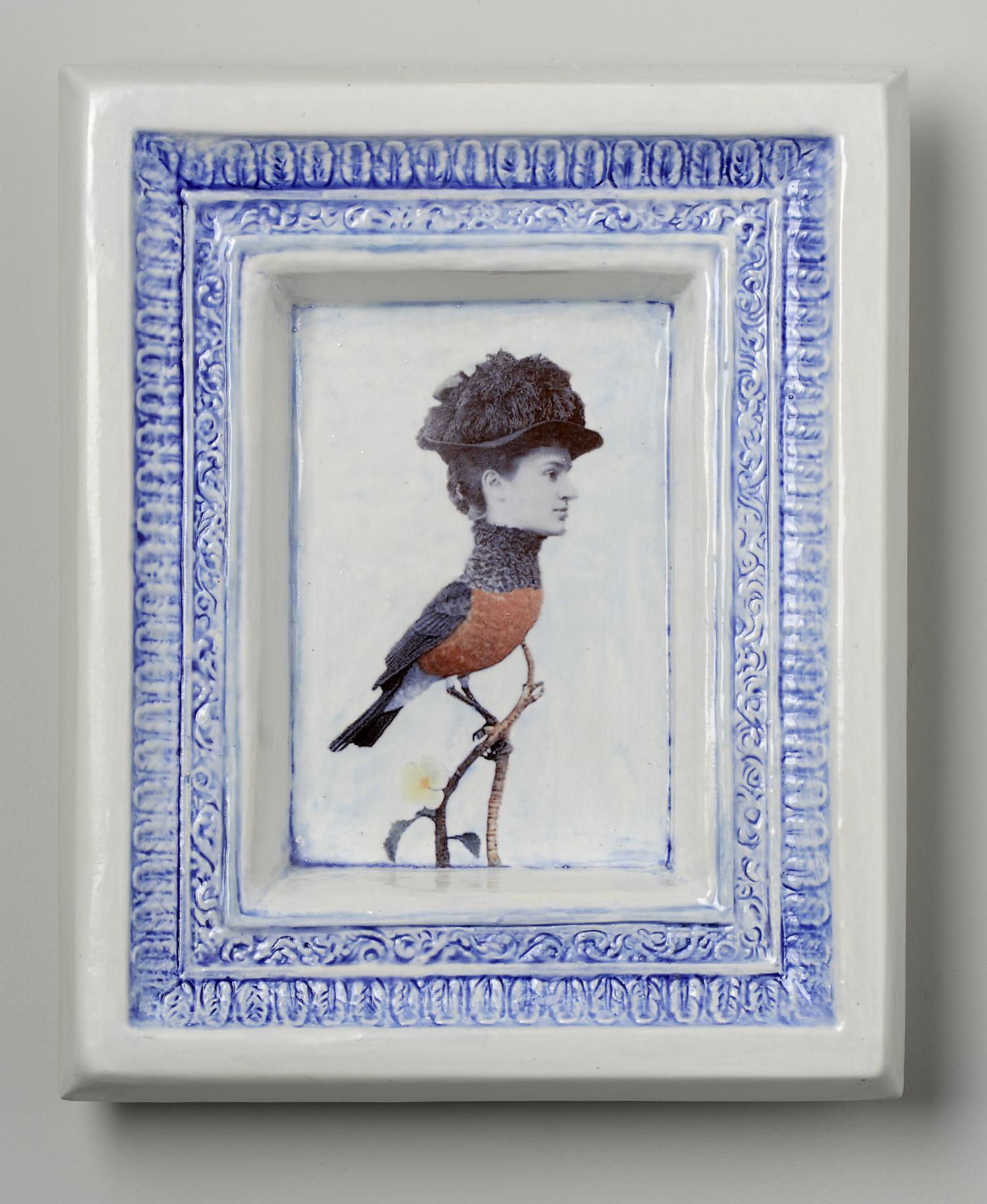Victorian women's portrait photo on body of bird. Ceramic decal on ceramic frame.