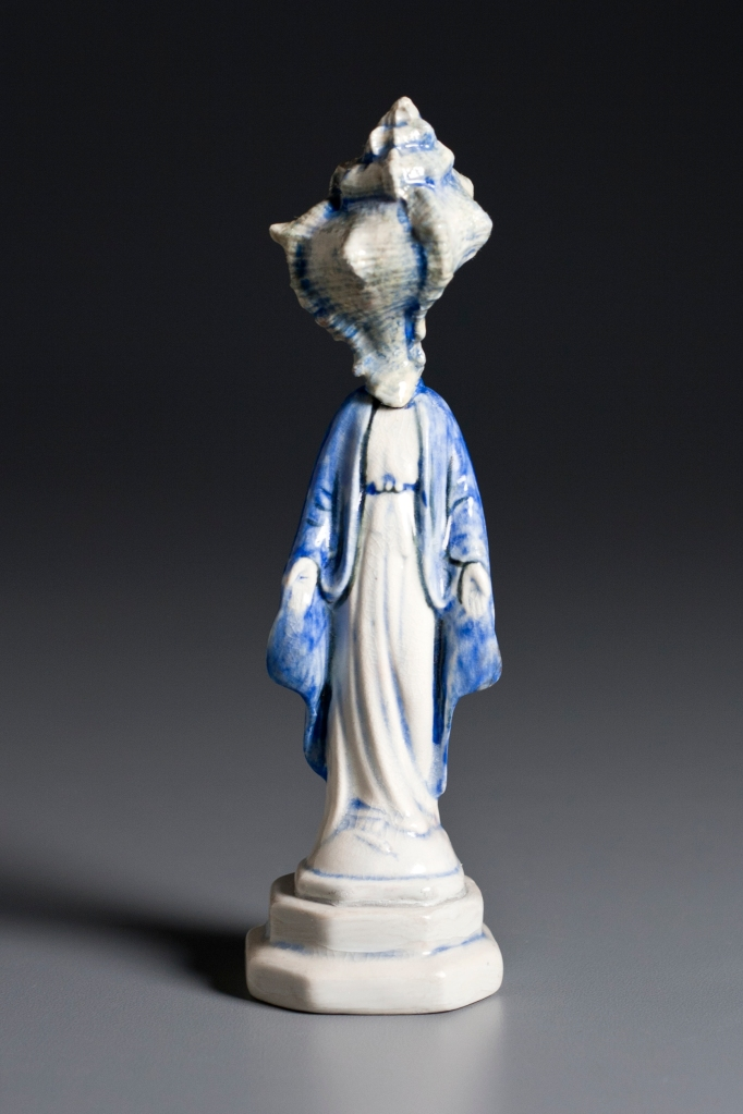 "Sea Virgin, 2012, porcelain, glaze, oils, 6.25"" x  1.75"" x 1.75""."
