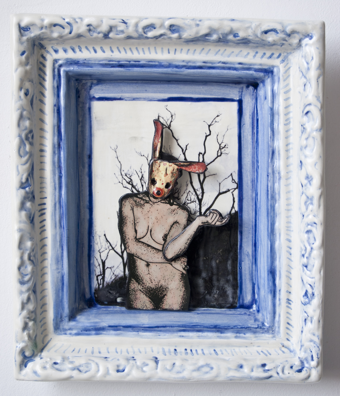 rabbit masked nude with dark trees behind