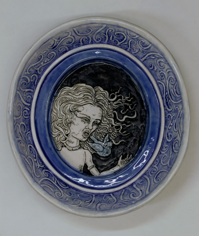 Ceramics, decal of girl with flowing hari and blue bird coming out of her mouth, oval frame