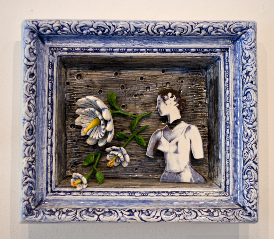 ceramic relief of women in foundation garment, no lower arms, head separate, decals from 1950 bra advertisment, large 3D flowers coming from mouth